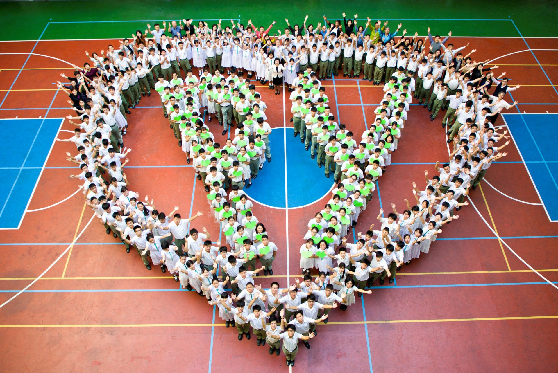 Pui Ying children in one heart